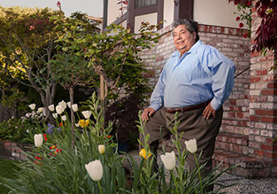 Man standing in front yard